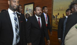 "FILE - In this Sunday, Feb. 9, 2020, file photo, Ethiopia's Prime Minister Abiy Ahmed, center, arrives for the opening session of the 33rd African Union (AU) Summit at the AU headquarters in Addis Ababa, Ethiopia. Ethiopia's prime minister on Wednesday, Nov. 4, 2020 ordered the military to confront the Tigray regional government after he said it attacked a military base overnight, citing months of ""provocation and incitement"" and declaring that ""the last red line has been crossed."" (AP Photo, File)"