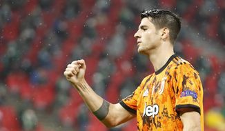 Juventus' Alvaro Morata celebrates after scoring the opening goal during the Champions League Group G soccer match between Ferencvaros and Juventus at the Puskas Arena in Budapest, Hungary, Wednesday, Nov. 4, 2020. (AP Photo/Laszlo Balogh)