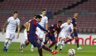 Barcelona's Lionel Messi scores a penalty kick during the Champions League group G soccer match between FC Barcelona and Dynamo Kyiv at the Camp Nou stadium in Barcelona, Spain, Wednesday, Nov. 4, 2020. (AP Photo/Joan Monfort)