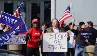 """Supporters of President Trump demonstrate in Atlanta — hoping to """"stop the steal"""" of the presidential election due to possible voter fraud. (Associated Press)"""