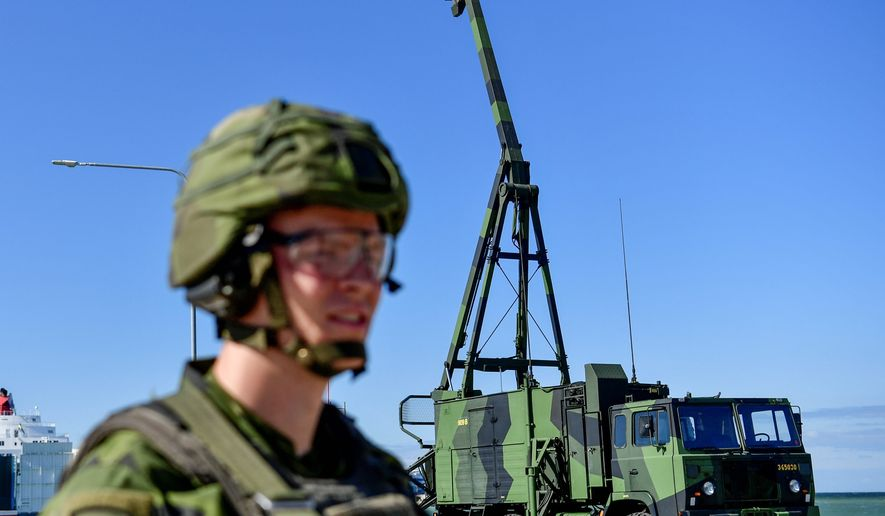 Swedish soldier mans a missile defensive position in Visby, Sweden, Monday July 1, 2019.  Sweden's military said on Monday it would deploy an updated ground-to-air missile defense system on the Baltic Sea island of Gotland in another sign of tension in the region with Russia. (Henrik Montgomery / TT via AP)