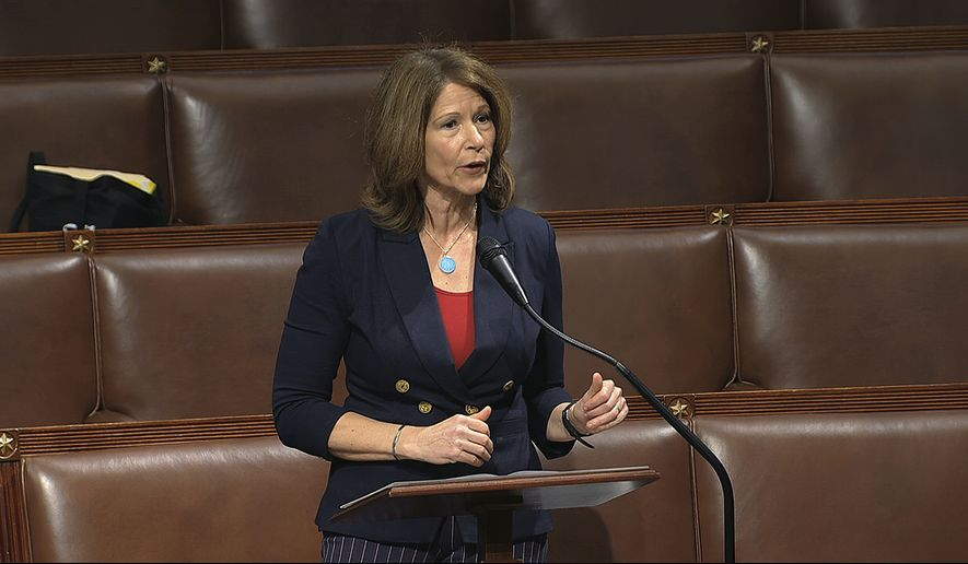 Rep. Cheri Bustos, D-Ill., speaks on the floor of the House of Representatives at the U.S. Capitol in Washington. (House Television via AP, File)