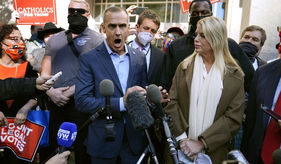 President Donald Trump's campaign adviser Corey Lewandowski, center, speaks about a court order obtained to grant more access to vote counting operations at the Pennsylvania Convention Center, Thursday, Nov. 5, 2020, in Philadelphia, following Tuesday's election. At right is former Florida Attorney General Pam Bondi. (AP Photo/Matt Slocum)  **FILE**