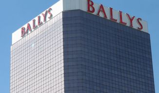 """This Oct. 1, 2020, photo shows the exterior of Bally's casino in Atlantic City, N.J. On Nov. 4, 2020, officials with Twin River Worldwide Holdings, a Rhode Island firm that's buying Bally's for $25 million, said they can make it """"a place to see and be seen"""" by investing $90 million into the aging casino and boosting its offerings. (AP Photo/Wayne Parry)"""