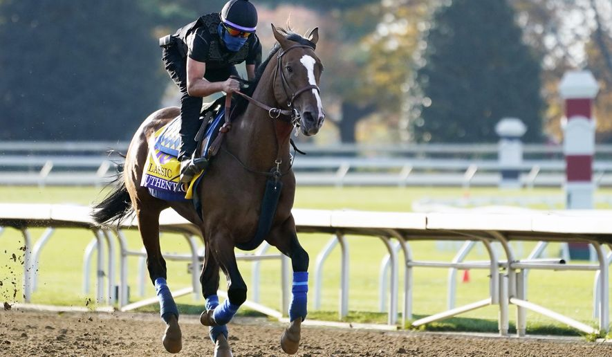 Kentucky Derby winner Authentic is taken for a workout at the Breeders' Cup World Championship horse races at Keeneland Race Course Thursday, Nov. 5, 2020, in Lexington, Ky. Authentic is scheduled to run in the Breeders' Cup Classic race Saturday. (AP Photo/Mark Humphrey)