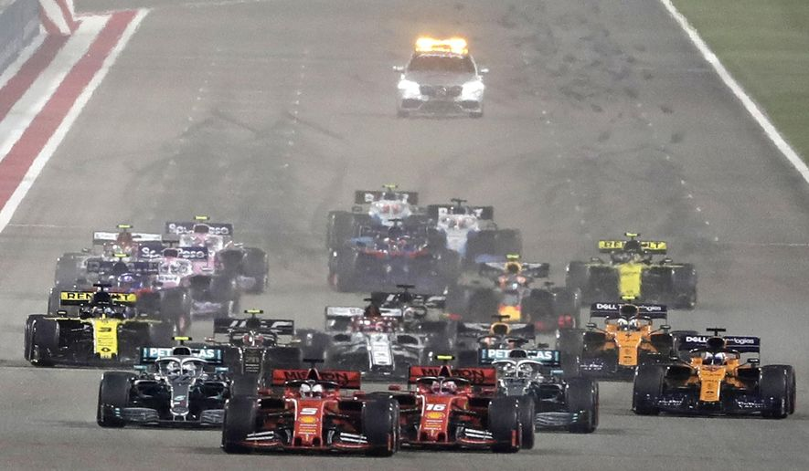 FILE - In this Sunday, March 31, 2019 file photo, Ferrari driver Charles Leclerc of Monaco, center right, and Ferrari driver Sebastian Vettel of Germany, center left, steer their cars during the start of the Baharain Formula One Grand Prix at the Bahrain International Circuit in Sakhir, Bahrain.  Saudi Arabia says it will host a Formula One race starting next year.  The kingdom says on Thursday, Nov. 5, 2020,  it will host the race in November 2021 in the Red Sea city of Jiddah. (AP Photo/Hassan Ammar, File)