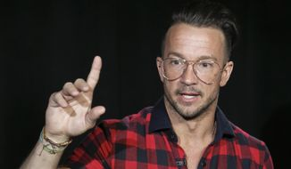 Carl Lentz appears during an interview on Oct. 23, 2017, in New York. Lentz, the pastor from global megachurch Hillsong, who once ministered to Justin Bieber and a bevy of other celebrities and sports stars, has been fired. He acknowledged on Instagram that he cheated on his wife. (AP Photo/Bebeto Matthews, File)