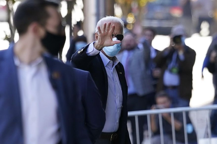 Democratic presidential candidate former Vice President Joe Biden waves as he arrives at the Queen theatre for meetings, Thursday, Nov. 5, 2020, in Wilmington, Del. (AP Photo/Carolyn Kaster)