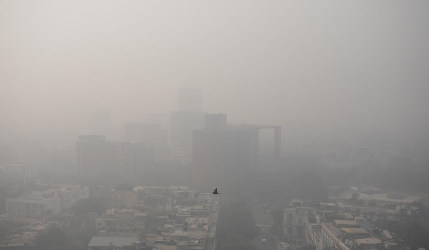 Smog envelopes the skyline in New Delhi, India, Wednesday, Nov. 4, 2020. The national capital, one of the world's most polluted cities, enjoyed a respite from air pollution up until September in part thanks to a virus lockdown. But with industrial activities resuming and cars back on the roads — along with the onset of cooler weather and less wind — air quality in the city has once again fallen to unhealthy levels. (AP Photo/Altaf Qadri)