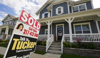 "FILE - A ""sold"" sign is posted on a home in Westfield, Ind., Friday, Sept. 25, 2020.  On Thursday, Nov. 5, U.S. long-term mortgage rates were flat to lower this week, as the key 30-year rate fell to a new all-time low for the 12th time this year.   (AP Photo/Michael Conroy)"