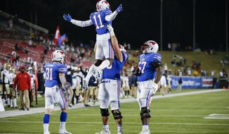 SMU offensive lineman Beau Morris (78) lifts wide receiver Rashee Rice (11) in celebration after Rice scored a touchdown during the second half of the team's NCAA college football game against Navy, Saturday, Oct. 31, 2020, in Dallas. (AP Photo/Brandon Wade)