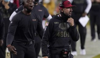 San Francisco 49ers head coach Kyle Shanahan, right, yells during the first half of an NFL football game between the 49ers and the Green Bay Packers in Santa Clara, Calif., Thursday, Nov. 5, 2020. (AP Photo/Tony Avelar)