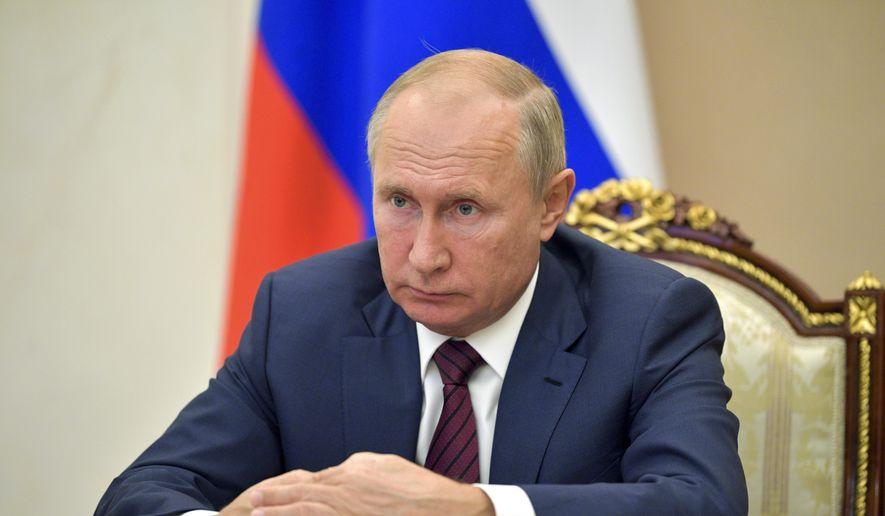 Russian President Vladimir Putin attends a meeting via video conference in Moscow, Russia, Thursday, Nov. 5, 2020. (Alexei Druzhinin, Sputnik, Kremlin Pool Photo via AP)