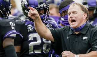 FILE - TCU head coach Gary Patterson shouts instructions to his players during an NCAA College football game against Oklahoma in Fort Worth, Texas, in this Saturday, Oct. 24, 2020, file photo. The Horned Frogs (2-3) haven't won at home in more than a year. They play against Texas Tech, who hasn't won a game on the road this season, on Saturday, Nov. 7. (AP Photo/Brandon Wade, File)