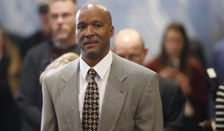 FILE - In this Feb. 24, 2020, file photo, Karl Dorrell enters a news conference after he was named football coach at Colorado, in Boulder, Colo. Dorrell starts his stint as Colorado coach by facing UCLA, where he played in the 1980s and served as coach from 2003 to 2007. (AP Photo/David Zalubowski, File)