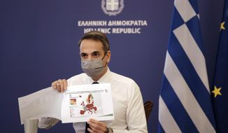 "In this photo provided by the Greek Prime Minister's Office, Greece's Prime Minister Kyriakos Mitsotakis shows a map of Europe during his announcement on the country's new lockdown in Athens, Thursday, Nov. 5, 2020. Mitsotakis has announced a nationwide three-week lockdown starting Saturday morning, saying that the increase in the coronavirus infections must be stopped before Greece's health care system comes under ""unbearable"" pressure. (Dimitris Papamitsos/Greek Prime Minister's Office via AP)"