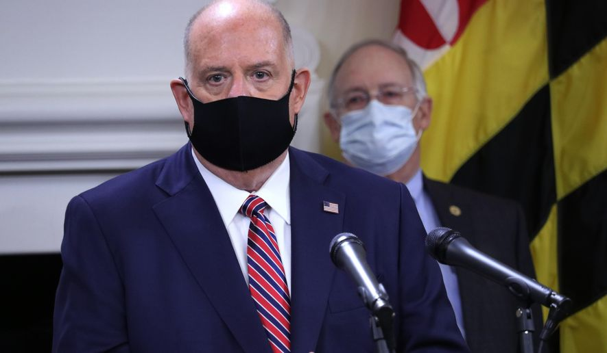 Maryland Gov. Larry Hogan urges people to wear masks to prevent the spread of the coronavirus as the nation experiences rising numbers of cases, while speaking at a news conference Thursday, Nov. 5, 2020, in Annapolis, Md. Hogan said masks are the best way to fight the virus to keep people safe and keep Maryland open for business. Maryland Health Secretary Robert Neall stands behind Hogan. (AP Photo/Brian Witte)