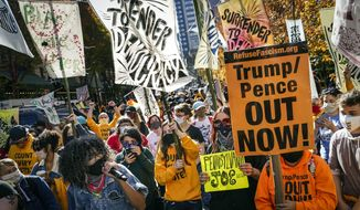 People urge for all votes to be counted as they demonstrate outside the Pennsylvania Convention Center where votes are being counted, Friday, Nov. 6, 2020, in Philadelphia. (AP Photo/John Minchillo)
