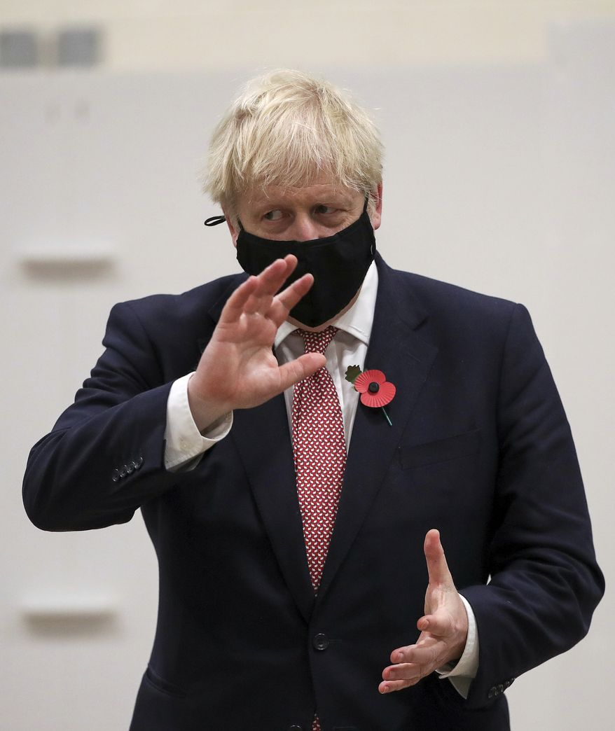 Britain's Prime Minister Boris Johnson gestures during a visit to a coronavirus testing center in De Montfort University, Leicester, England, in this file photo from Friday Nov. 6, 2020.  Mr. Johnson on Nov. 7 sent along his congratulations to President-elect Joseph R. Biden upon news that major news organizations had called the election in his favor. (Molly Darlington/Pool via AP)  **FILE**