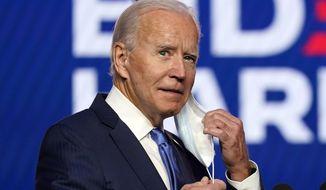 Democratic presidential candidate former Vice President Joe Biden arrives to speak Friday, Nov. 6, 2020, in Wilmington, Del. (AP Photo/Carolyn Kaster)