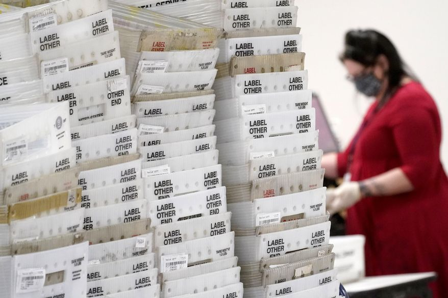 Stacks of ballots await to be counted for the general election inside the Maricopa County Recorder's Office, Friday, Nov. 6, 2020, in Phoenix. (AP Photo/Matt York)
