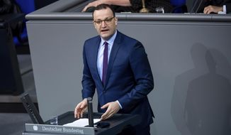 Jens Spahn, Federal Minister of Health, speaks in the plenary session of the German Bundestag in Berlin, Germany, Friday, Nov. 6, 2020. The main topics of the 190th session of the 19th legislative period are various debates on measures to be taken in the wake of the Corona pandemic, jobs in the automotive industry, the global situation of religious freedom, and the situation of the older generation. (Bernd von Jutrczenka/dpa via AP)