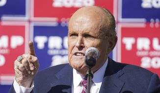 Former New York mayor Rudy Giuliani, a lawyer for President Donald Trump, speaks during a news conference on legal challenges to vote counting in Pennsylvania, Saturday Nov. 7, 2020, in Philadelphia. (AP Photo/John Minchillo)