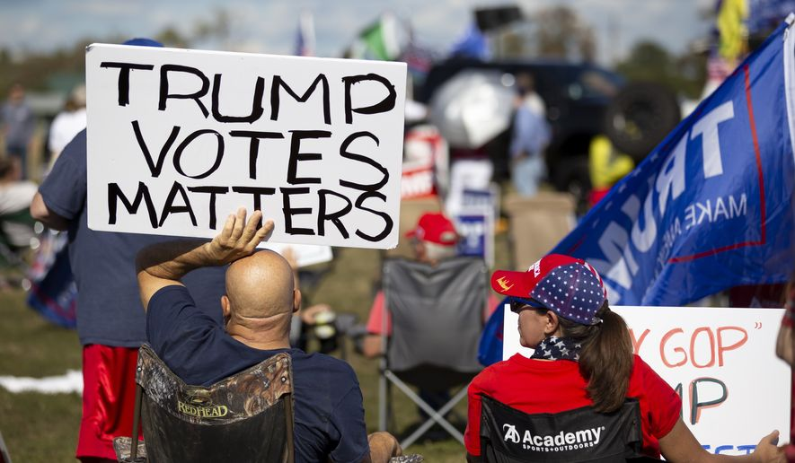 Hundreds gathered for a Defend Our President rally held at the Montgomery County Fairgrounds in Conroe, Saturday, Nov. 7, 2020. Elected officials such as U.S. Rep. Kevin Brady and State Rep. Steve Toth spoke to attendees asking for contributions to President Trump's legal defense. (Gustavo Huerta/Houston Chronicle via AP)