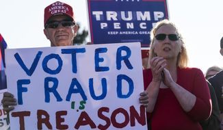 In this file photo, supporters of President Donald Trump react at a rally after it was announced that President-elect Joe Biden defeated President Trump Saturday, Nov. 7, 2020, in Milwaukee.  The Trump campaign is asking for a recount of votes cast in Dane and Milwaukee Counties. (AP Photo/Morry Gash)  **FILE**