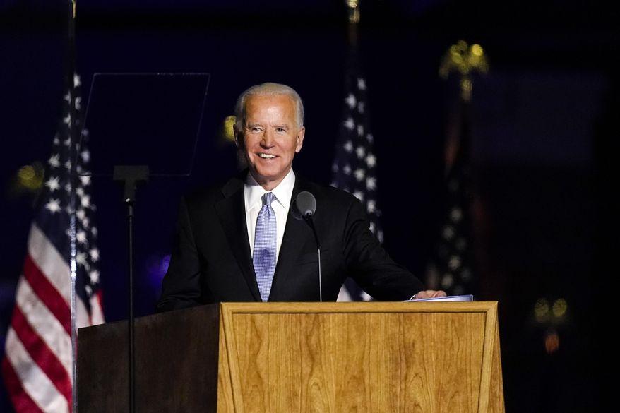 Presumptive President-elect Joe Biden speaks Saturday, Nov. 7, 2020, in Wilmington, Del. (AP Photo/Andrew Harnik)  **FILE**
