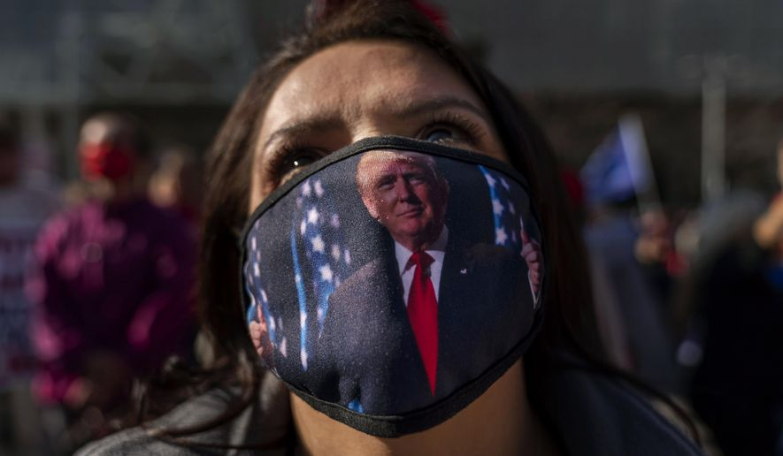Trump supporter Teresa Rorick attends a protest against the election results outside the central counting board at the TCF Center in Detroit, Friday, Nov. 6, 2020. (AP Photo/David Goldman)