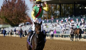Pierre-Charles Boudot, celebrates atop Audarya after winning the Breeders' Cup Filly & Mare Turf horse race at Keeneland Race Course, in Lexington, Ky., Saturday, Nov. 7, 2020. (AP Photo/Darron Cummings)