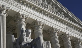 The Supreme Court in Washington on the day after the election, Wednesday, Nov. 4, 2020. (AP Photo/J. Scott Applewhite)