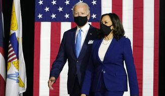 In this Aug. 12, 2020, file photo, Democratic presidential candidate former Vice President Joe Biden and his running mate Sen. Kamala Harris, D-Calif., arrive to speak at a news conference at Alexis Dupont High School in Wilmington, Del. (AP Photo/Carolyn Kaster, File)