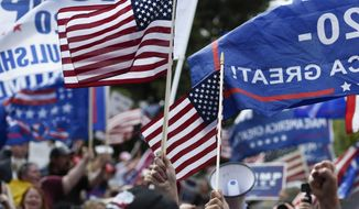President Donald Trump supporters cheer during a rally, Saturday, Nov. 7, 2020, in Atlanta. (AP Photo/Mike Stewart)