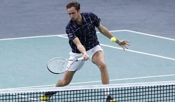 Russia's Daniil Medvedev returns the ball to Canada's Milos Raonic during their semi-final game of the Paris Masters tennis tournament in Paris, Saturday, Nov. 7, 2020. (AP Photo/Thibault Camus)