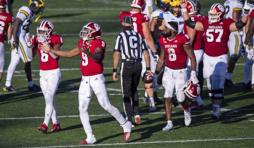 Indiana quarterback Michael Penix Jr. (9) and his teammates react after defeating Michigan in an NCAA college football game Saturday, Nov. 7, 2020, in Bloomington, Ind. Indiana won 38-21. (AP Photo/Doug McSchooler)