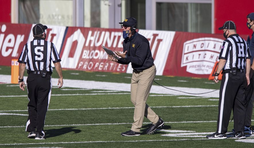 Michigan head coach Jim Harbaugh reacts towards a game official after a call during the second half of an NCAA college football game against Indiana, Saturday, Nov. 7, 2020, in Bloomington, Ind. Indiana won 38-21. (AP Photo/Doug McSchooler)