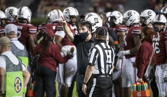 South Carolina coach Will Muschamp points to the video screen during the first half of the team's NCAA college football game against Texas A&M on Saturday, Nov. 7, 2020, in Columbia, S.C. (AP Photo/Sean Rayford)