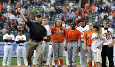 In this April 6, 2009, file photo, Vice President Joe Biden throws out the first pitch prior to the Baltimore Orioles and the New York Yankees opening day baseball game at Camden Yards in Baltimore. The Washington Nationals have invited President-elect Biden to throw out the ceremonial first ball when they host the New York Mets at Nationals Park on opening day next season. (AP Photo/Gail Burton, File)  **FILE**