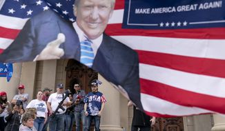 Trump supporters gather on the steps of the State Capitol to protest the presidential election results in Lansing, Mich., Sunday, Nov. 8, 2020. (AP Photo/David Goldman)