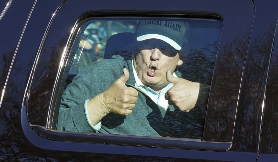 President Donald Trump gives two thumbs up as he departs after playing golf at the Trump National Golf Club in Sterling Va., Sunday Nov. 8, 2020. (AP Photo/Steve Helber)