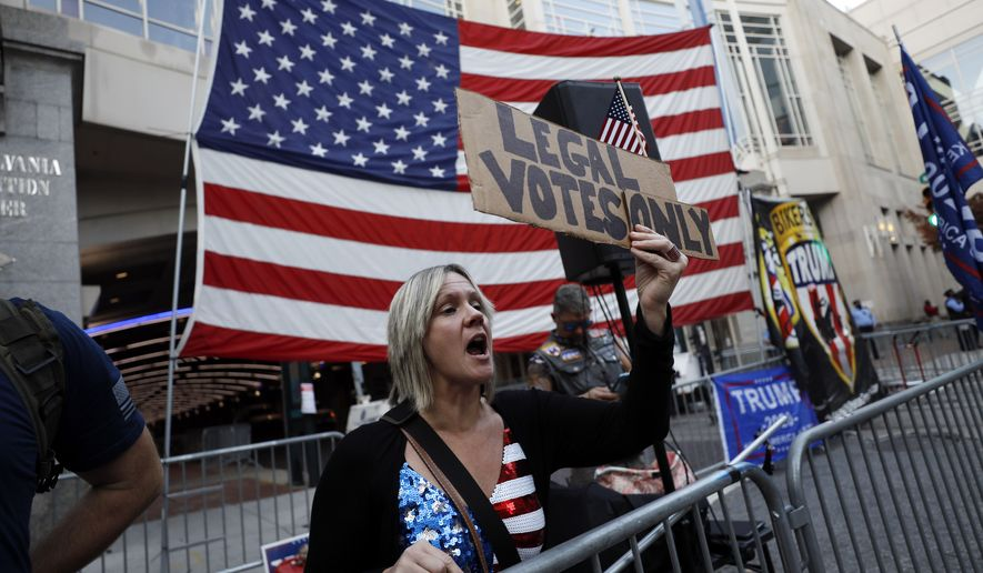 A woman shouts toward supporters of President-elect Joe Biden, as supporters of President Donald Trump protest outside the Pennsylvania Convention Center in Philadelphia, Sunday, Nov. 8, 2020, a day after the 2020 election was called for Democrat Biden. (AP Photo/Rebecca Blackwell)