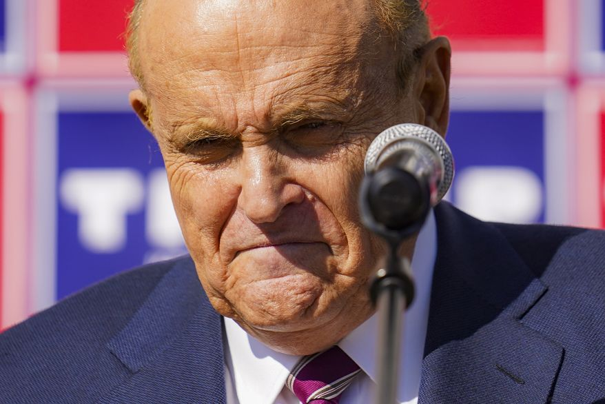 Former New York mayor Rudy Giuliani, a lawyer for President Donald Trump, pauses as he speaks during a news conference on legal challenges to vote counting in Pennsylvania, Saturday Nov. 7, 2020, in Philadelphia.