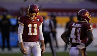 Washington Football Team quarterback Alex Smith (11) runs back to the sidelines during a break in the second half of an NFL football game against the New York Giants, Sunday, Nov. 8, 2020, in Landover, Md. New York won 23-20. (AP Photo/Patrick Semansky)