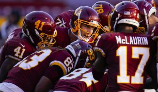 Washington Football Team quarterback Alex Smith (11) in the huddle with his team during the second half of an NFL football game against the New York Giants, Sunday, Nov. 8, 2020, in Landover, Md. New York won 23-20. (AP Photo/Patrick Semansky)