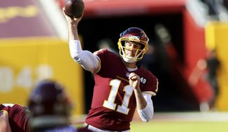 Washington Football Team quarterback Alex Smith (11) in action during an NFL football game against the New York Giants, Sunday, Nov. 8, 2020 in Landover, Md. (AP Photo/Daniel Kucin Jr.)