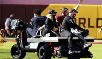 Washington Football Team quarterback Kyle Allen (8) gets carted off the field during an NFL football game against the New York Giants, Sunday, Nov. 8, 2020 in Landover, Md. (AP Photo/Daniel Kucin Jr.)