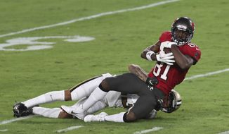 Tampa Bay Buccaneers wide receiver Antonio Brown (81) is taken down by New Orleans Saints cornerback Marshon Lattimore during the second half of an NFL football game Sunday, Nov. 8, 2020, in Tampa, Fla. (AP Photo/Mark LoMoglio)