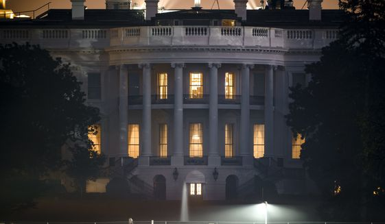 The White House in Washington, is seen early Sunday, Nov. 8, 2020, the morning after incumbent President Donald Trump was defeated by his Democratic challenger, President-elect Joe Biden. Vice President-elect Kamala Harris is set to become the highest-ranking woman in the nation's history. (AP Photo/J. Scott Applewhite)